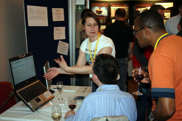 Beth explaining our product to a couple of interested delegates
